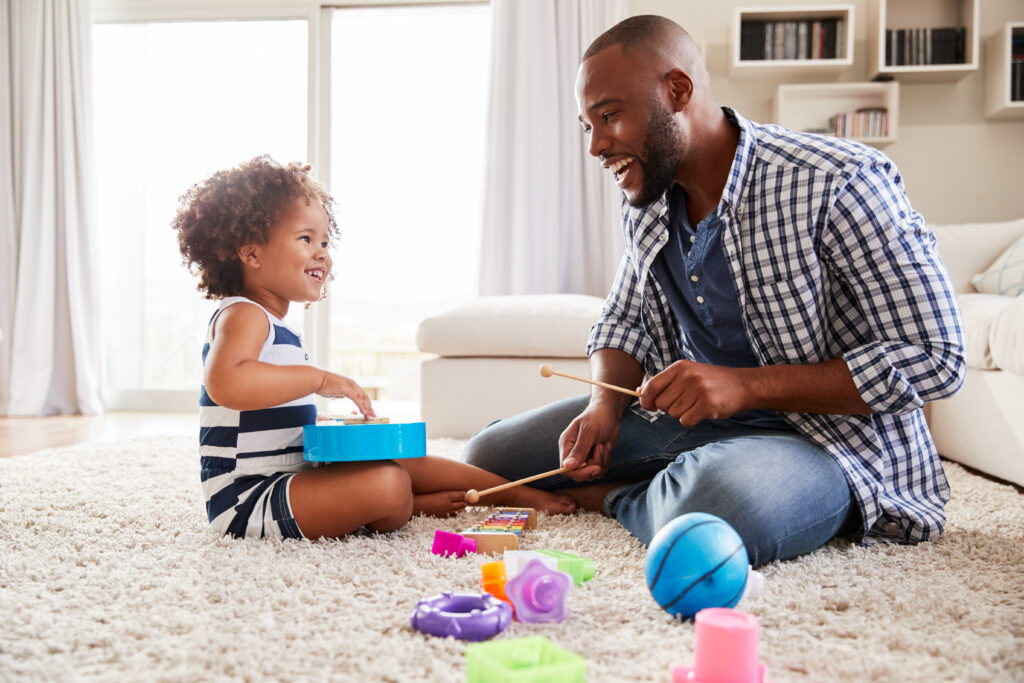 Young,Black,Father,Playing,With,Daughter,In,The,Sitting,Room